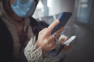 Buy stock photo Cropped shot of a woman using her phone in the airpot