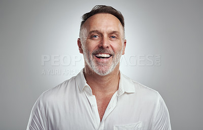 Buy stock photo Studio portrait of a mature man standing against a grey background