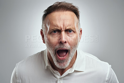 Buy stock photo Studio portrait of a mature man yelling against a grey background
