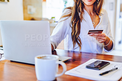 Buy stock photo Shot of an unrecognisable woman using a laptop and credit card at home