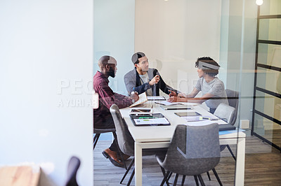 Buy stock photo Shot of a group of businesspeople having a meeting in a boardroom