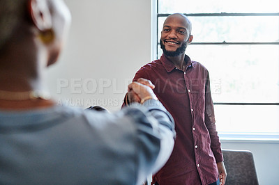 Buy stock photo Shot of businesspeople shaking hands during a meeting in an office