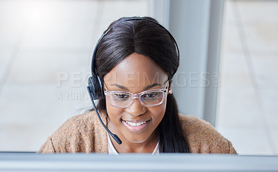 Buy stock photo Shot of a businesswoman at her desk in her office