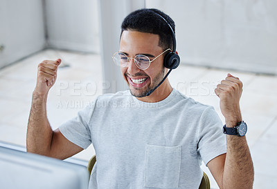 Buy stock photo Shot of a young businessman working in a call center office helping a client