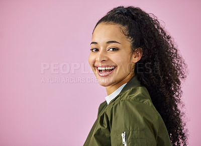 Buy stock photo Shot of an attractive young woman standing alone against a pink background in the studio