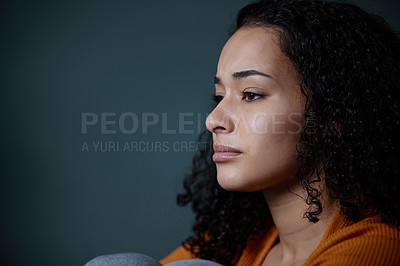 Buy stock photo Shot of a young woman feeling unhappy at home