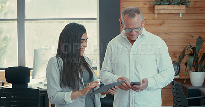 Buy stock photo Shot of a young businesswoman having a meeting with her boss using a digital tablet