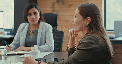 Buy stock photo Shot of two female businesswomen in a work meeting at their office