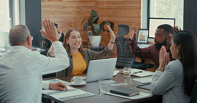 Buy stock photo Shot of a diverse group of work colleagues celebrating success during a business meeting