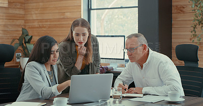 Buy stock photo Shot of a group of businesspeople planning a project with the manager during a meeting at their office