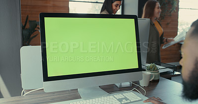 Buy stock photo Shot of a young businessman using his desktop computer
