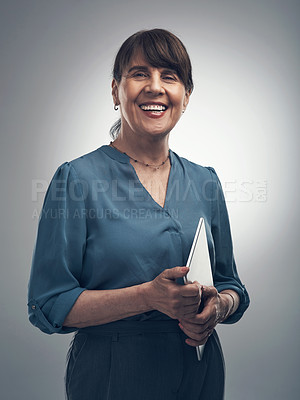 Buy stock photo Cropped shot of an attractive mature woman posing in studio against a grey background