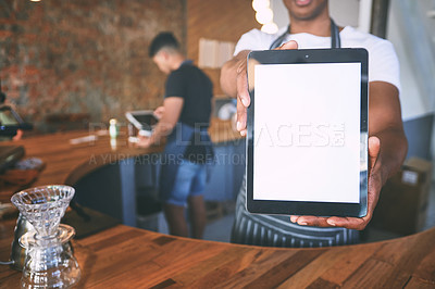 Buy stock photo Shot of a man showing a digital tablet with a blank screen while working in a cafe
