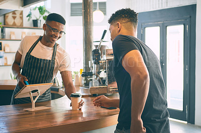Buy stock photo Shot of a young man being served coffee in a cafe