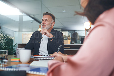 Buy stock photo Shot of a team of businesspeople having a meeting in the boardroom of a modern office