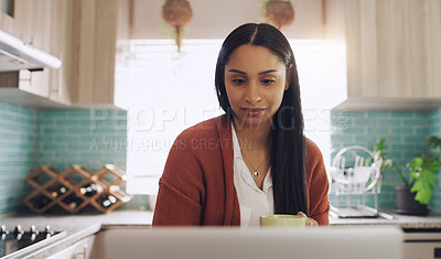 Buy stock photo Shot of a young businesswoman working at home using her laptop