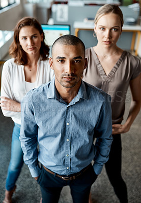 Buy stock photo Shot of a diverse group of businesspeople standing together in the office during the day