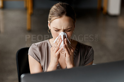 Buy stock photo Shot of an attractive young businesswoman sitting alone at her desk and feeling sick