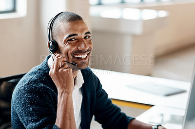 Buy stock photo Portrait of a young businessman wearing a headset while working in an office