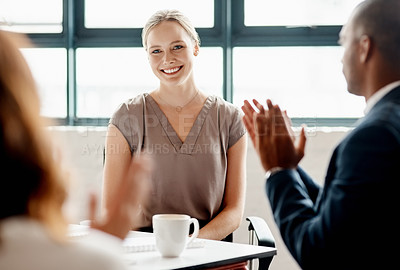 Buy stock photo Shot of a young businesswoman receiving applause during a meeting in an office