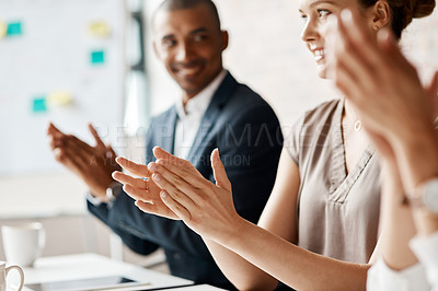 Buy stock photo Closeup shot of a group of businesspeople applauding during a meeting in an office