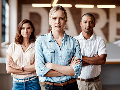 Buy stock photo Portrait of a group of confident young businesspeople working together in a modern office