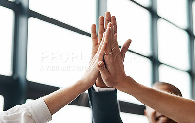 Buy stock photo Closeup shot of a group of unrecognisable businesspeople giving each other a high five in an office
