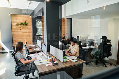 Buy stock photo Shot of a group of businesspeople working in an office