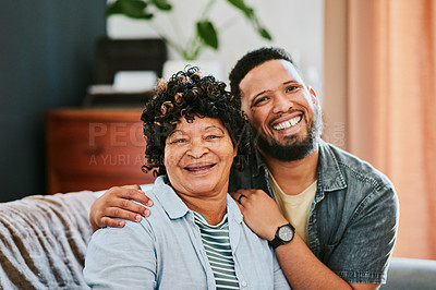 Buy stock photo Shot of an elderly woman relaxing with her son on the sofa at home
