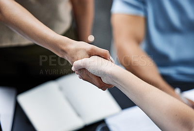 Buy stock photo Shot of businesspeople greeting each other with a handshake