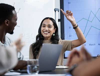 Buy stock photo Shot of a businesswoman raising her hand during a business meeting with her colleagues