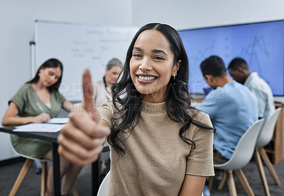 Buy stock photo Shot of a young businesswoman giving the thumbs up during a successful business meeting