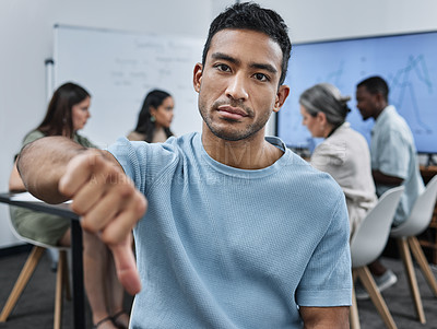 Buy stock photo Shot of a young businessman during a team meeting