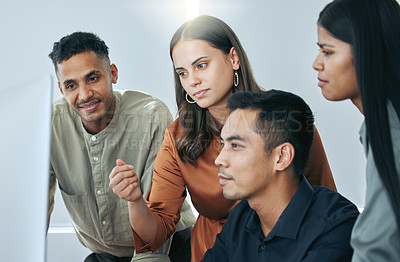 Buy stock photo Shot of a diverse group of businesspeople standing together in the office and using a computer