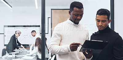 Buy stock photo Shot of a male businessman signing paperwork at the office