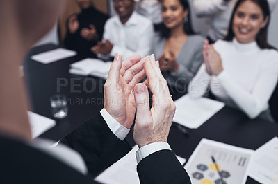 Buy stock photo Shot of a group of colleagues applauding a job well done
