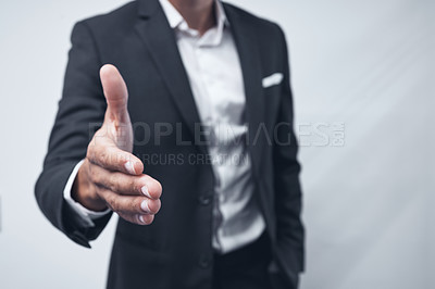 Buy stock photo Shot of an anonymous businessman holding out his hand for a handshake