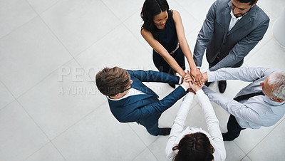 Buy stock photo Shot of a team of colleagues joining their hands together in unity
