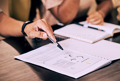 Buy stock photo Shot of businesspeople filling out paperwork