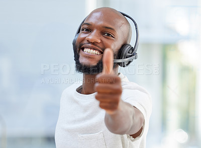 Buy stock photo Shot of a young businessman working in a call center