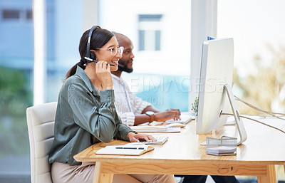 Buy stock photo Shot of two businesspeople working together in a call center