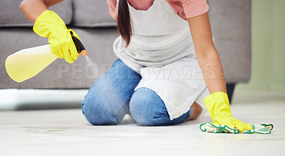Buy stock photo Cropped shot of a woman cleaning the floor at home