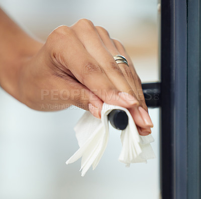 Buy stock photo Cropped shot of an unrecognizable woman wiping a door handle
