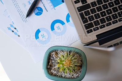 Buy stock photo High angle shot of a laptop and documents on a table in an empty home office during the day