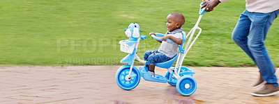 Buy stock photo Shot of a boy riding a bike in the park