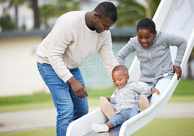 Buy stock photo Shot of a father and son playing in the park