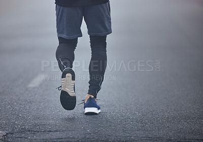 Buy stock photo Rearview shot of an unrecognisable man running outdoors