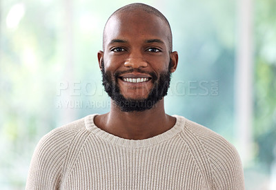 Buy stock photo Shot of a young man smiling at home