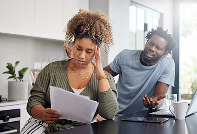 Buy stock photo Shot of a couple having an argument while going over their finances at home