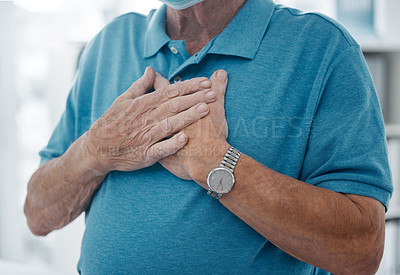 Buy stock photo Shot of an unrecognizable man holding his hands to his heart in a hospital